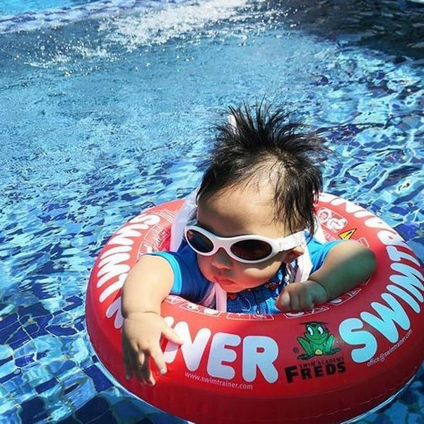 Baby in pool wearing Adventure Banz White sunglasses