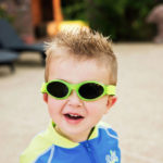 Boy in Adventure Banz sunglasses in Lime Green