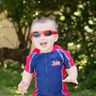 Boy in swimsuit and Adventure Banz Red sunglasses