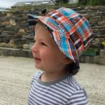 Boy in a Blue/Orange Check bucket sunhat