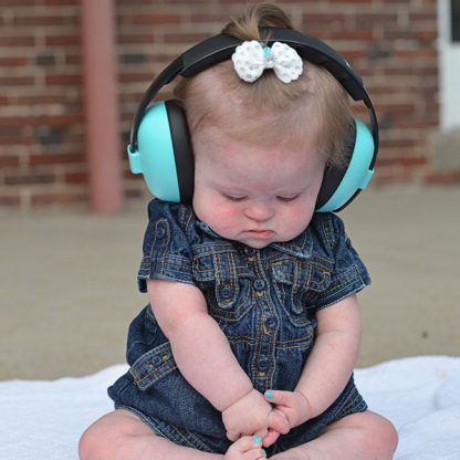Mini Earmuffs Aqua on sitting baby