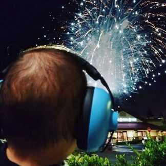 Baby wearing blue Mini Earmuffs watching fireworks