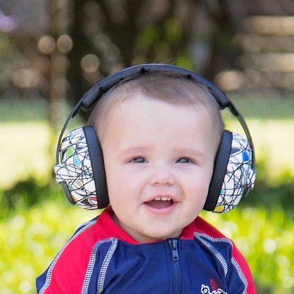 Little boy wearing Mini Earmuffs in Squiggle pattern