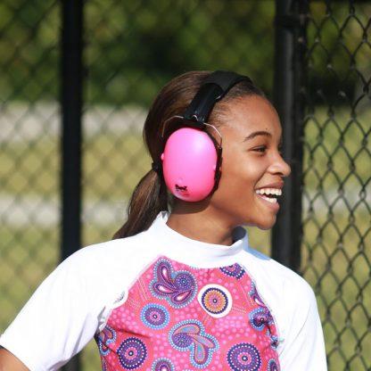 Teenage girl wearong Pink Protective earmuffs