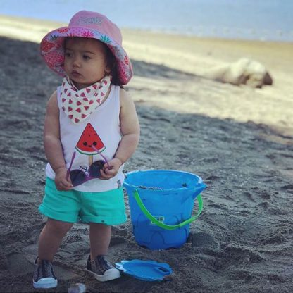 Girl in Reversible Sunhat in Pineapples/Pink