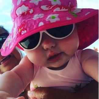 Baby wearing Hibiscus Pink Reversible Sunhat