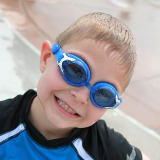 Boy wearing blue swimming goggles