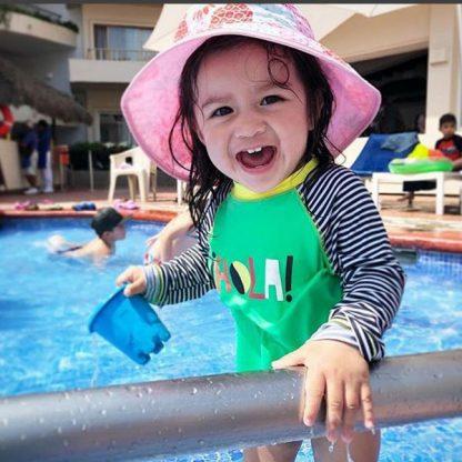 Girl in Reversible Sunhat in Pineapples/Pink