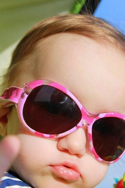 Baby girl in Retro Pink Diva sunglasses
