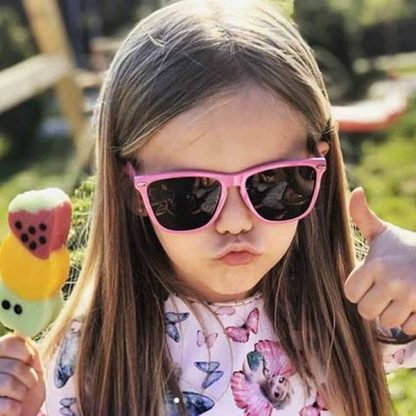 Girl wearing JBanz Flyers Pink sunglasses