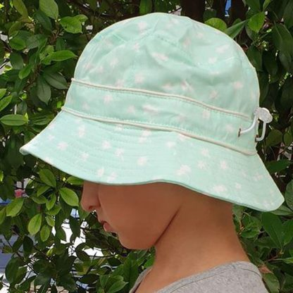 Child wearing Bucket Sunhat in Palm Tree Mint