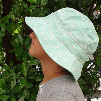 Childer wearin Bucket Sunhat in Palm Tree Mint fabric