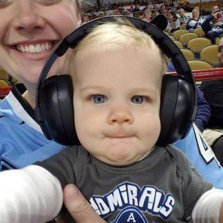 Baby wearing Black earmuffs