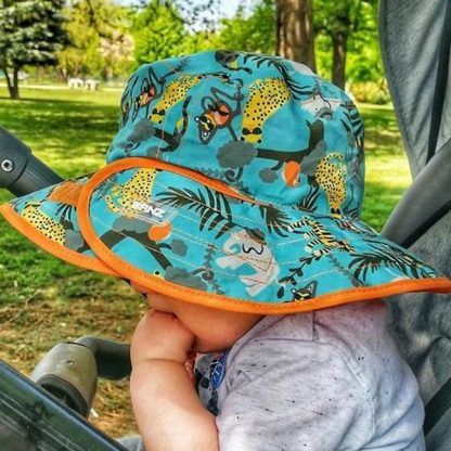 Reversible Sunhat Jungle on a baby